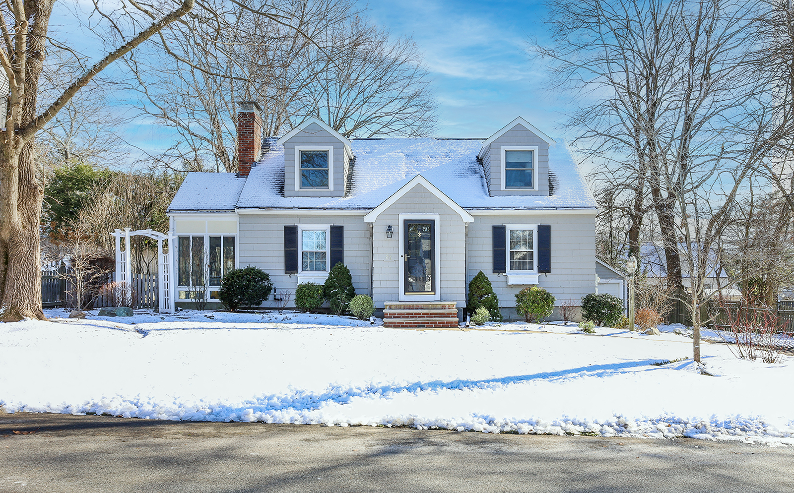 Front exterior photograph of a sold listing in Westwood MA on Circuit Drive